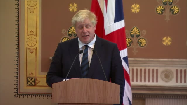 foreign secretary boris johnson in a press conference with john kerry speaking about previous comments he had made about hillary clinton and barack... - shock tactics stock videos and b-roll footage