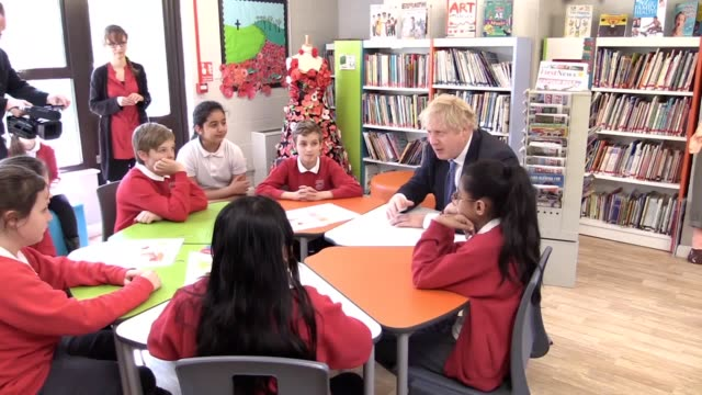 vídeos de stock, filmes e b-roll de foreign secretary boris johnson spoke to pupils at st leonard's church of england primary academy east sussex on thursday about his plans to see... - recebendo