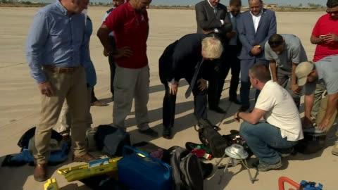 foreign secretary boris johnson visit; libya: tripoli: boris johnson chatting with men on visit to libyan coastguard johnson hoisting united kingdom... - hoisting stock videos & royalty-free footage