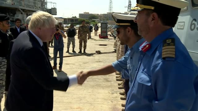 vídeos de stock, filmes e b-roll de foreign secretary boris johnson visit libya tripoli day boris johnson shaking hands with sailors on visit to libyan coastguard johnson asking one... - líbia