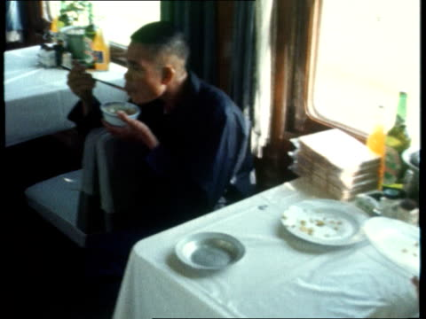 foreign secretary sir alec douglas-home travels to china; chinese man eating bowl of rice with chops sticks chinese diner scraping rice into bowl... - alec douglas home video stock e b–roll