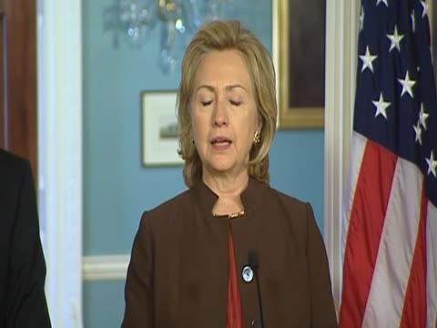 Foreign Secretary William Hague and US Secretary of State Hillary Clinton stand side by side to comment on exit strategy for allied forces from...