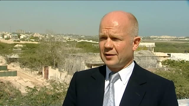 foreign secretary william hague visit somalia mogadishu william hague mp interview sot hague meeting mayor of mogadishu ext mayor of mogadishu... - アフリカの角点の映像素材/bロール