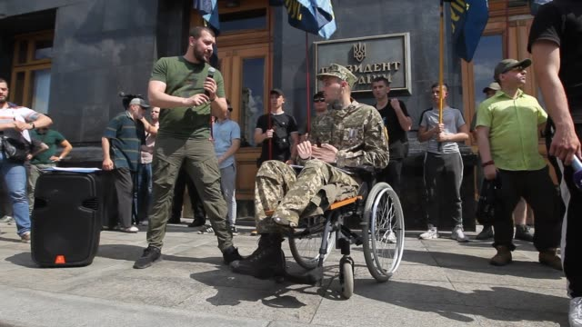 a foreign volunteer fighter stanislav from moldova speaks during a rally in support of foreign citizens who joined ukrainian armed forces and... - self defence stock videos & royalty-free footage