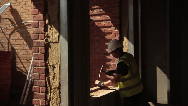 foreign workers on a residential construction site in london uk on monday july 29 2019 - development stock videos & royalty-free footage