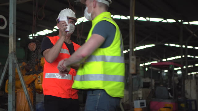 foreman is measure temperature factory workers at factory site. - health and safety stock videos & royalty-free footage