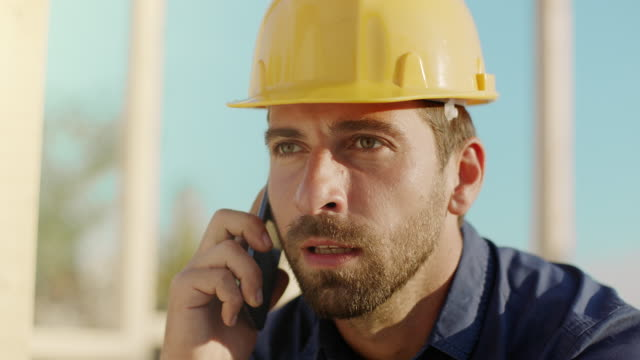 Foreman talking on the phone at construction site