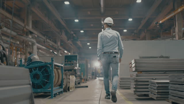 slo mo foreman walking through the manufacturing plant - manufacturing stock videos & royalty-free footage
