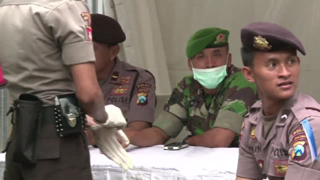 forensic experts are hard at work in surabaya identifying recovered bodies as search operations continue for doomed airasia flight 8501 - surabaya stock videos & royalty-free footage