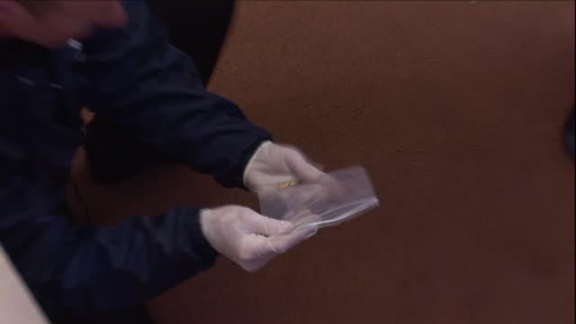 forensic investigators gather evidence at a crime scene. - criminal investigation stock videos & royalty-free footage