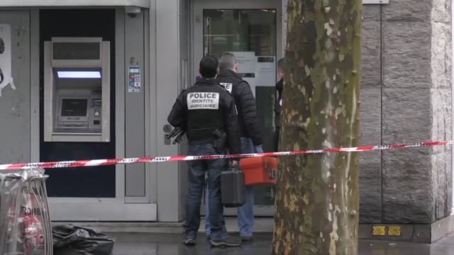Forensic police in Paris are gathering clues to try and identify armed robbers who carried out a bank heist near the ChampsElysees today less than...