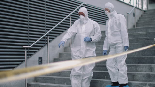 Forensic science team working on police investigation site