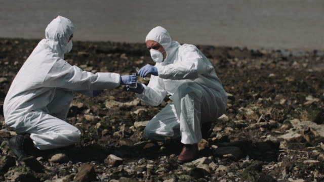 forensic scientist taking sample at river bank - detective stock videos & royalty-free footage