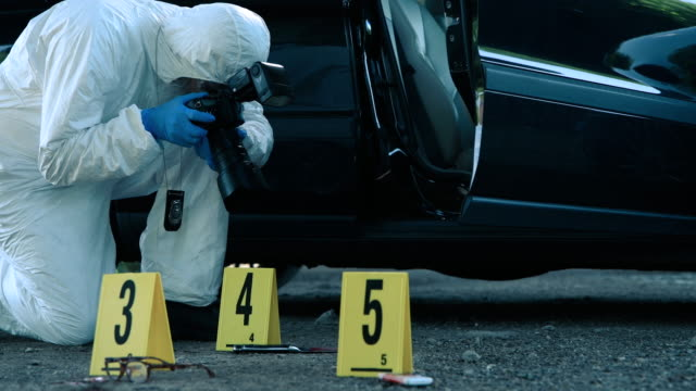 forensic scientist working at crime scene - photographer stock videos & royalty-free footage
