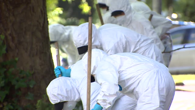 forensic terrorist officers search for evidence around forbury gardens, reading, where three men were killed during a knife attack terrorist incident - crime and murder stock videos & royalty-free footage