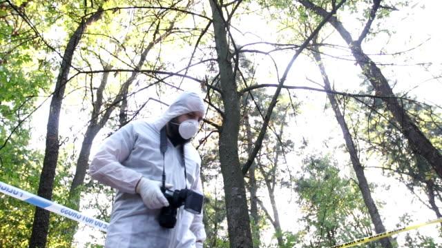 kriminalteknik på brottsplatsen - fotografiska teman bildbanksvideor och videomaterial från bakom kulisserna