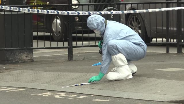 forensics experts examine the scene in westminster after british police swoop on a man armed with knives close to the houses of parliament - knife weapon stock videos and b-roll footage