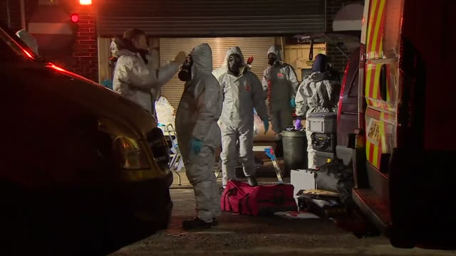 forensics officers in protective suits investigating the scene of the alleged poisoning of russian former spy sergei skripal and his daughter yulia - toxic substance stock videos & royalty-free footage