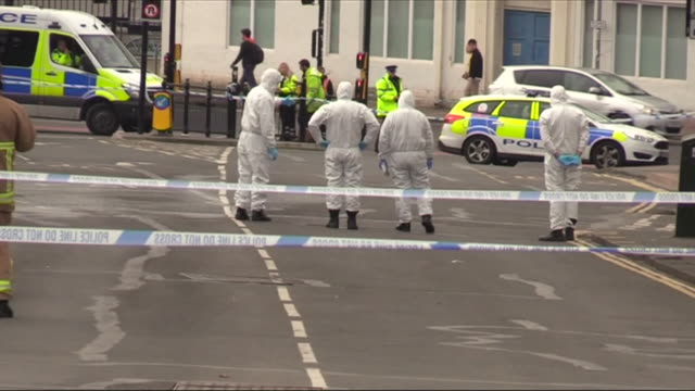 Forensics officers inspecting a crime scene in Brighton