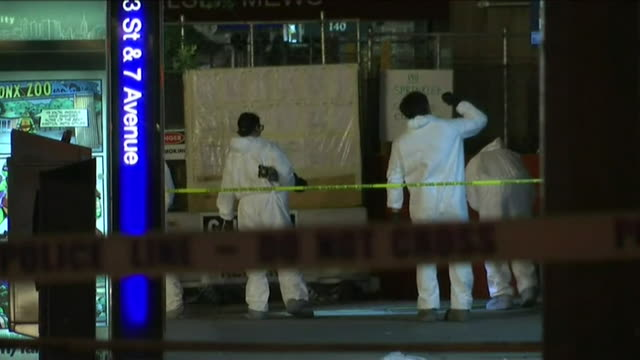 forensics teams in new york city combing the scene of a bomb explosion - evidence bag stock videos & royalty-free footage
