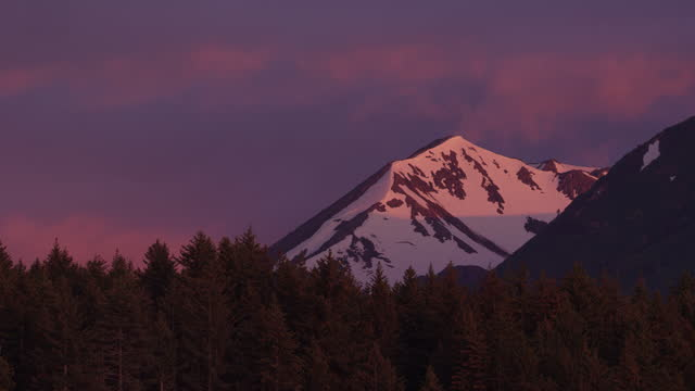 ws forest and mountain with pink sunset sky - mountain peak stock videos & royalty-free footage