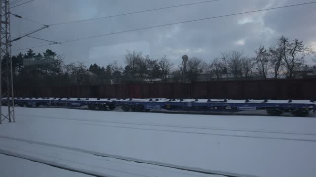 forest and rail tracks covered with snow seen from a moving train - pavel gospodinov stock videos & royalty-free footage