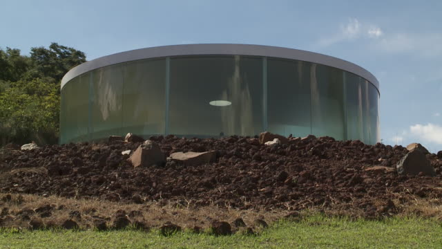 a forest and rugged landscaping surrounds the sonic pavilion in belo horizonte, brazil. - horizonte stock videos & royalty-free footage