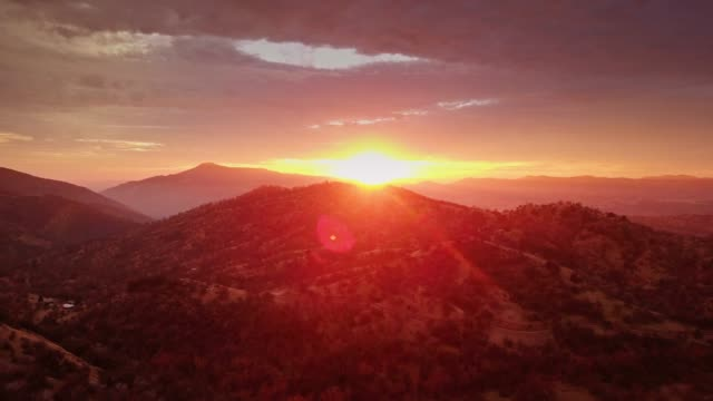 forest covered mountains at sunset - drone shot - californian sierra nevada stock videos and b-roll footage