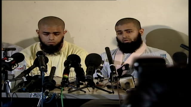 brothers first press conference; int reporters and camera crews filming press conference long shot of brothers, pierce, easter and others sitting at... - brother stock videos & royalty-free footage
