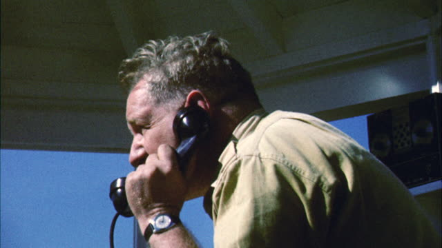 MS Forest ranger in tower talking on telephone