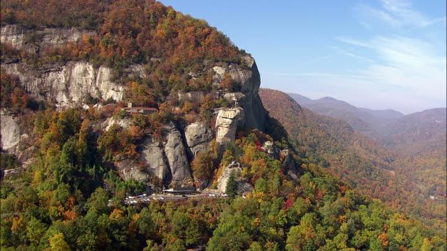 Forest trees change color at Chimney Rock in Chimney Rock State Park in North Carolina.
