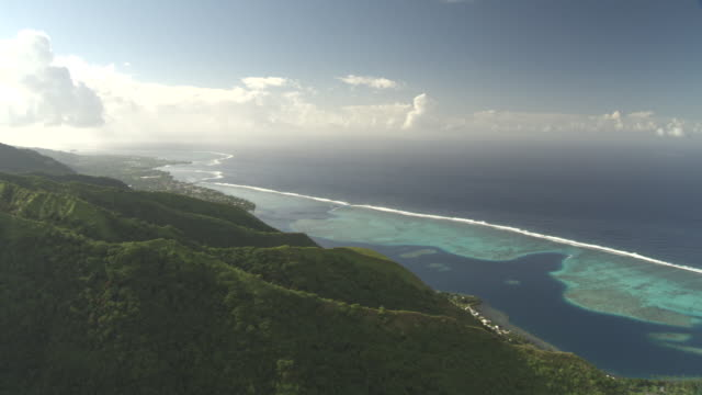 forested hills, lagoon and coral reef, tahiti, french polynesia - tahiti video stock e b–roll