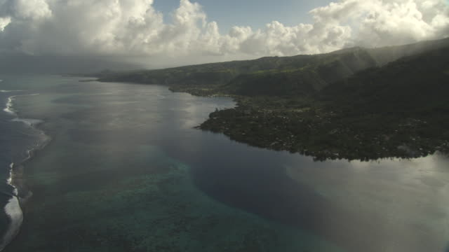 Forested hills, lagoon and coral reef, Tahiti, French Polynesia