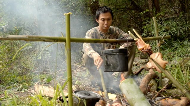 stockvideo's en b-roll-footage met forester preparing food. - bamboo plant