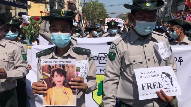 forestry department employees march in protest against the military coup on february 10 in yangon, myanmar. myanmar declared martial law in parts of... - ミャンマー点の映像素材/bロール