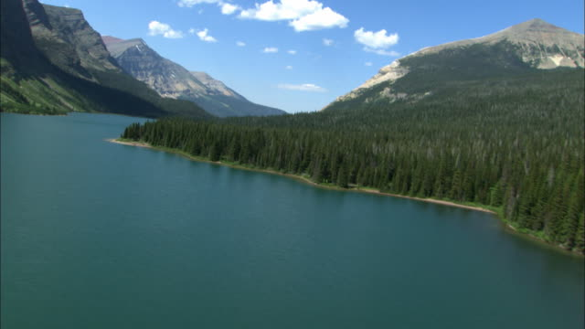 Forests surround a scenic mountain lake.