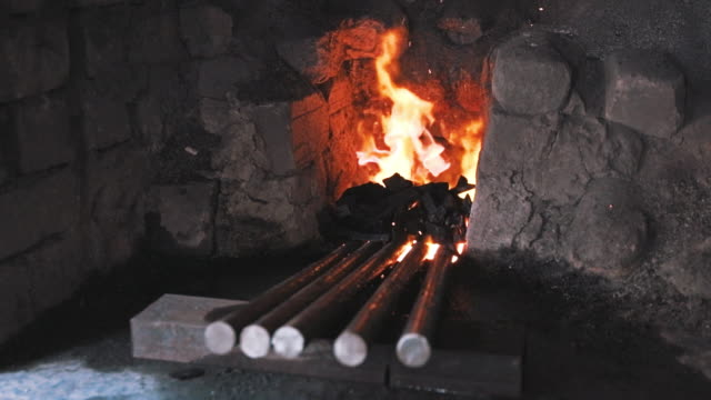forge with iron rods and fire in blacksmith workshop - craft product stock videos and b-roll footage