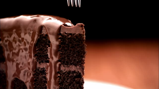 cu, fork being inserted in chocolate cake  - pampering stock videos & royalty-free footage