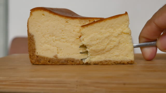 fork cutting cheese cake