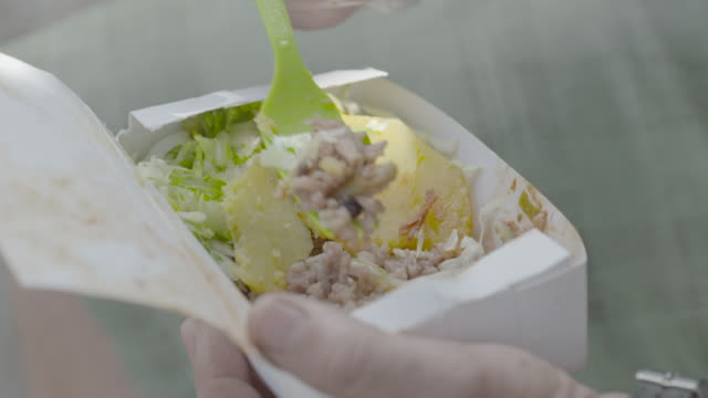 forkful of cuban salad from to-go box - take away food stock videos and b-roll footage