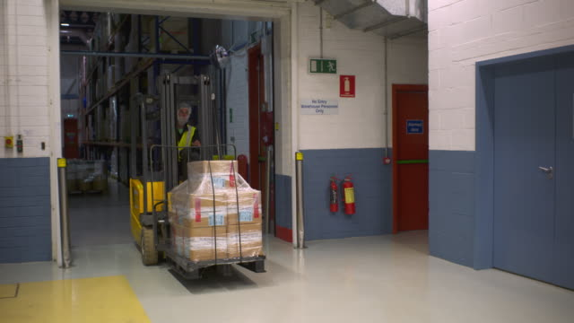 Forklift Carrying Pallet of Chemicals in a Lab