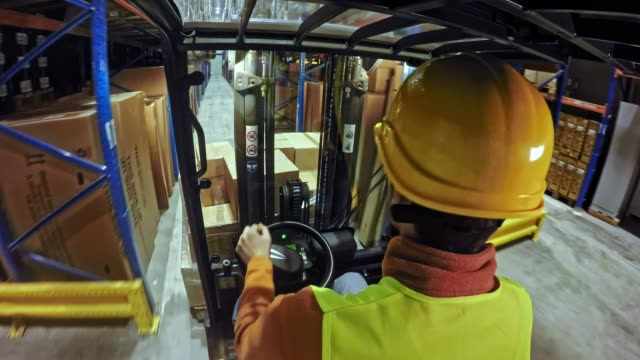ld forklift driver driving down the warehouse aisle - forklift truck stock videos and b-roll footage