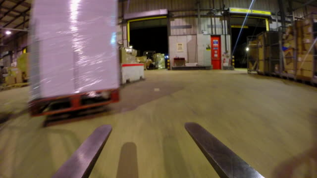 pov forklift drives around warehouse - cardboard box stock videos & royalty-free footage