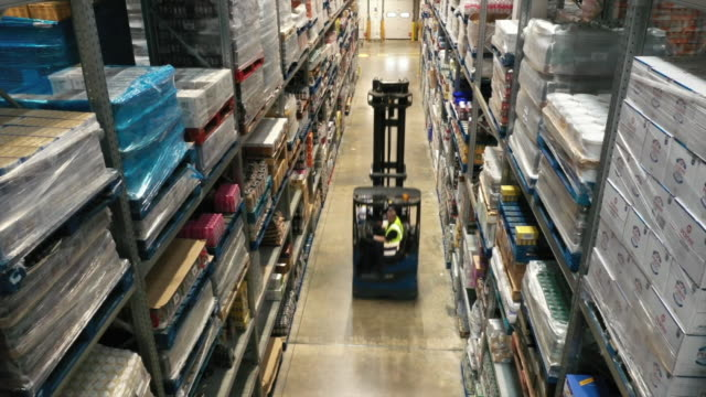 a forklift driving around a supermarket - shelf stock videos & royalty-free footage