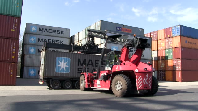 MS Forklift keeping down cargo container on container truck in container terminal at Wörth harbour / Wörth, Rhineland Palatinate, Germany