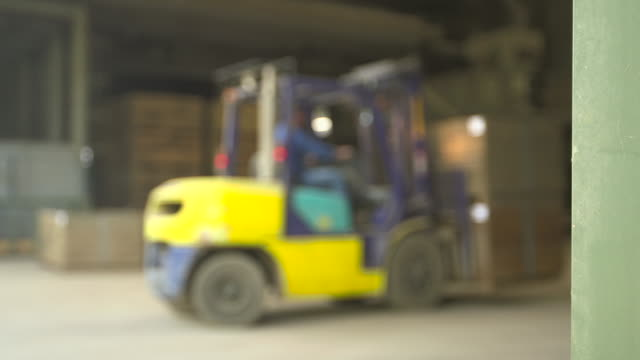 forklift manoeuvres crates in warehouse, scotland, uk - carton stock videos & royalty-free footage