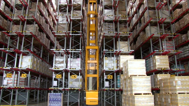 MS Forklift moving between parcels storage at warehouse of catalog company / Grossostheim, Bavaria, Germany