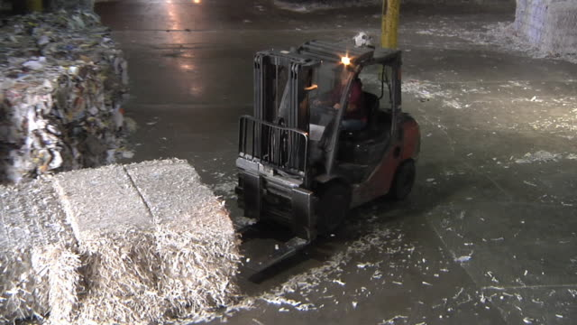 ws zo forklift operator moves bales of recycled paper / manistique, michigan, usa - heap stock videos & royalty-free footage