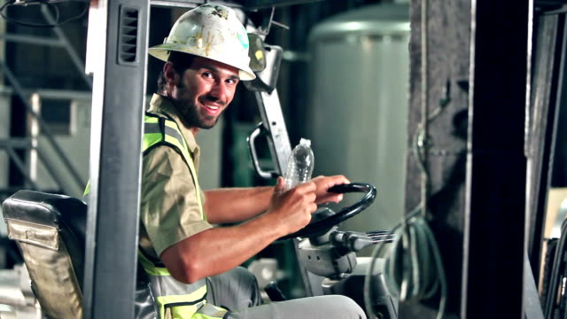 forklift operator taking a break, drinking water - water factory stock videos and b-roll footage