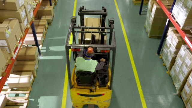 forklift operator working in the warehouse - forklift truck stock videos and b-roll footage